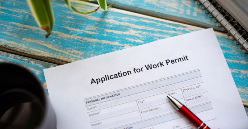 An application form for a work visa lying on a table